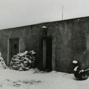 Photo taken after war. Chimney and door rebuilt.